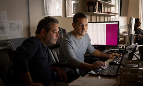 WPI researchers on computers.